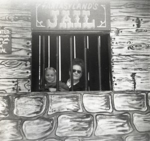 "Girl and Adult Lady posing in the ""Jail"" window."