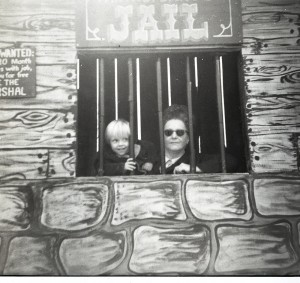 "Boy and Adult Lady posing in the ""Jail"" window."
