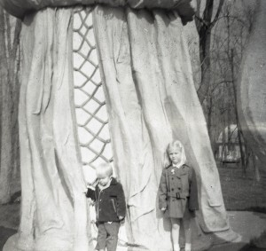 Two children in front of the Mother Goose Statue.
